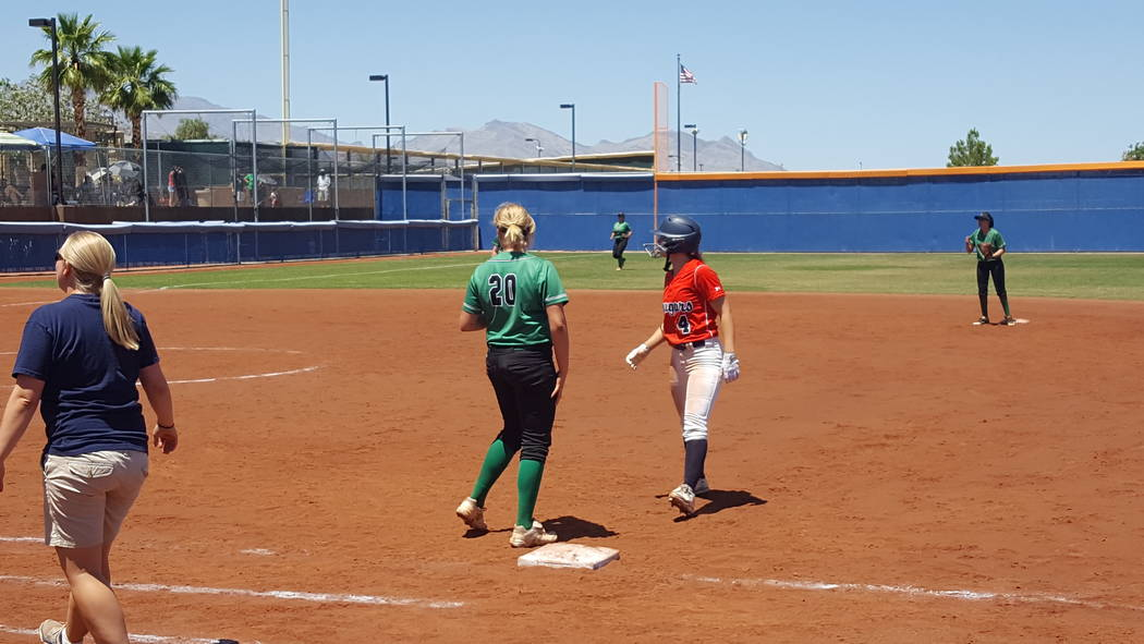 Coronado senior Dylan Underwood (4) retreats to first base after one of her four hits in the Class 4A Sunrise Region softball championship Saturday at Bishop Gorman. (David Schoen/Las Vegas Review ...