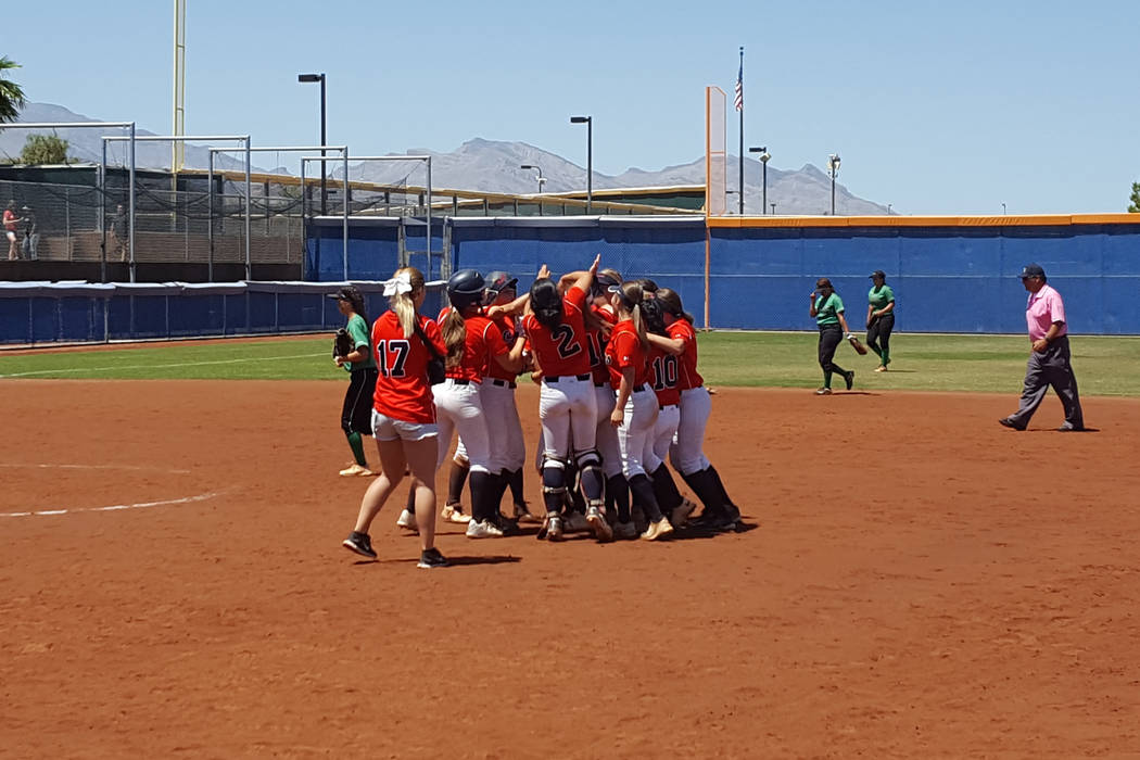 Coronado's softball team mobs Tatum Spangler after her winning hit in the bottom of the seventh inning of the Class 4A Sunrise Region softball championship Saturday at Bishop Gorman. (David Schoen ...