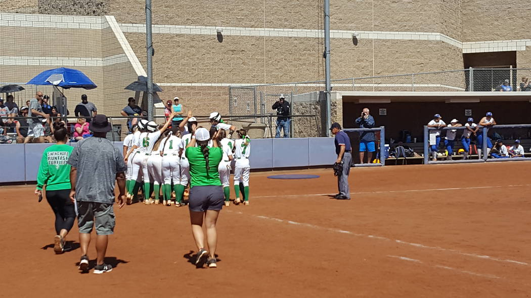 Cara Beatty is greeted at home plate by her Palo Verde teammates after hitting a grand slam in the fourth inning of the Class 4A Sunset Region softball championship Saturday at Bishop Gorman. (Dav ...