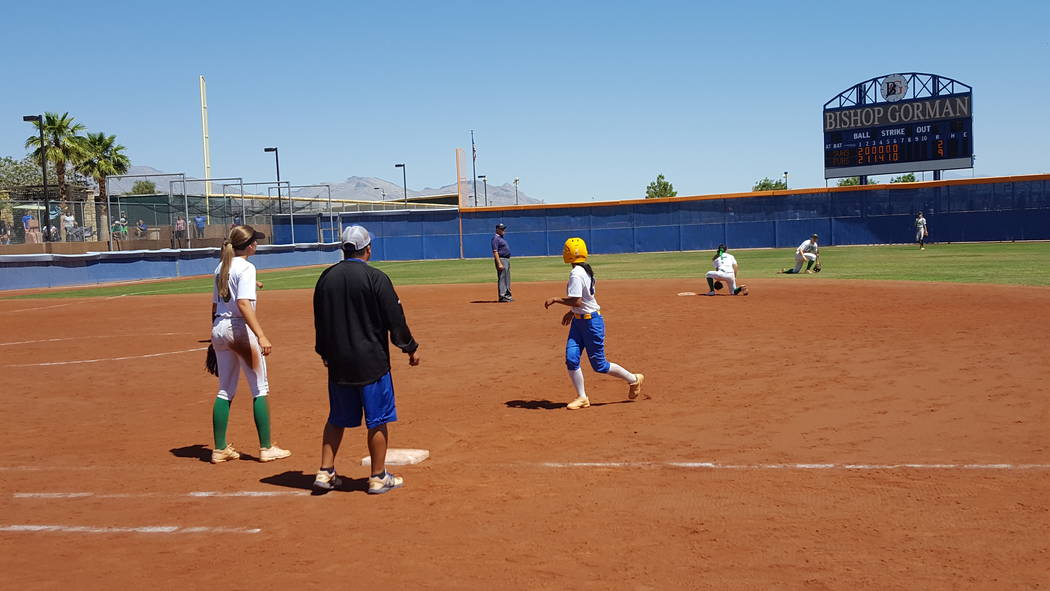 Taylor DeGuzman of Sierra Vista retreats to first base after hitting a single to lead off the seventh inning of the Class 4A Sunset Region softball championship Saturday at Bishop Gorman. (David S ...