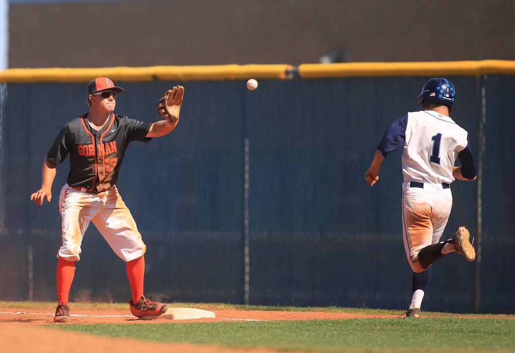 Bishop Gorman first baseman Nick Israel (13) catches a ball to put out Centennial runner Cole Sliwoski (1) during the Sunset Region baseball championship game between Centennial High School and Bi ...
