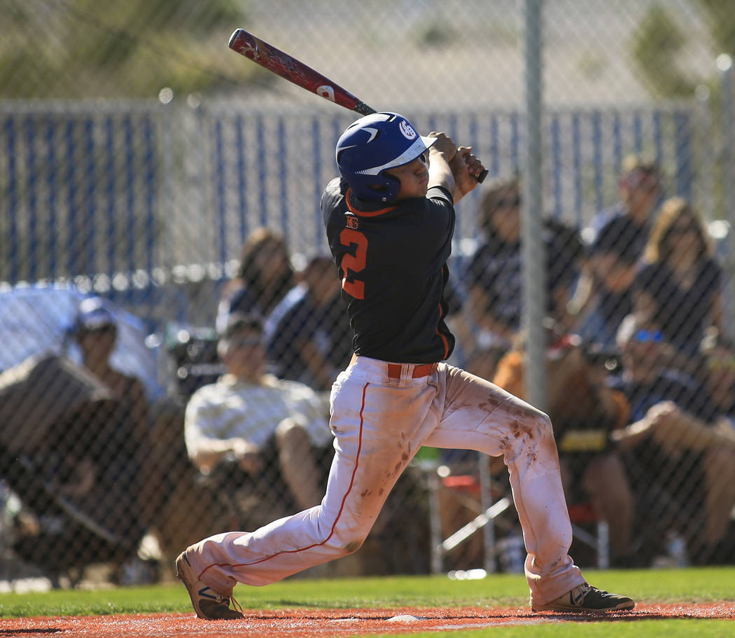 Bishop Gorman batter Tyler Curtis (2) takes a swing during the Sunset Region baseball championship game between Centennial High School and Bishop Gorman High School at Centennial High School on Sa ...