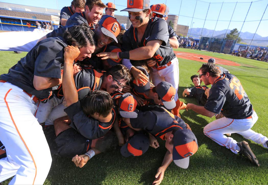 Bishop Gorman players celebrate winning the Sunset Region baseball championship game over Centennial High School at Centennial on Saturday, May 13, 2017. Bishop Gorman won 11-8. Brett Le Blanc Las ...