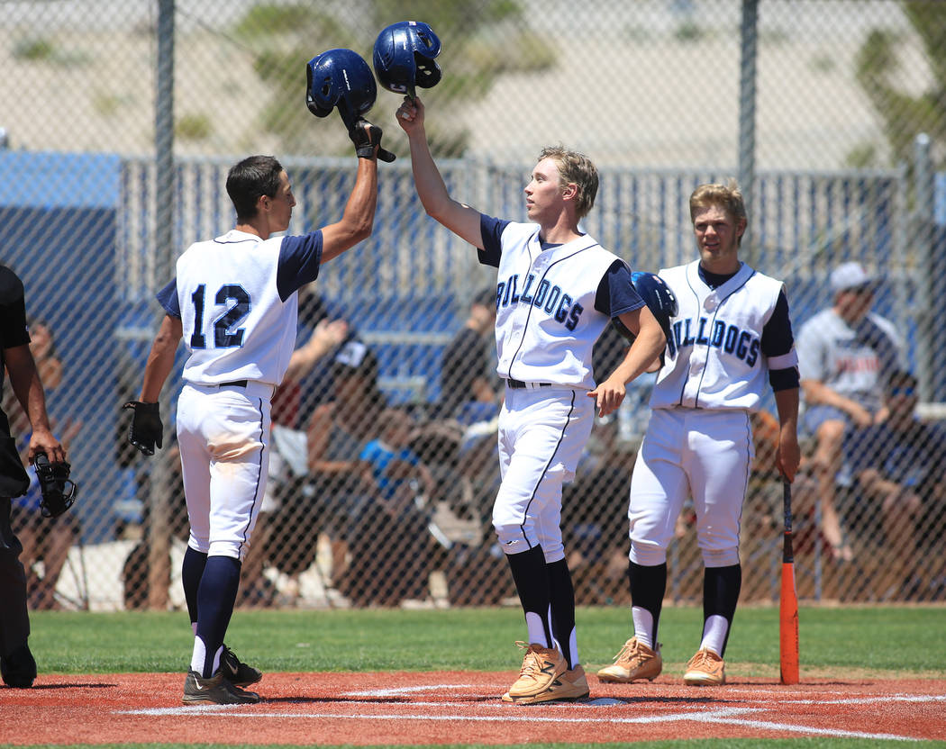 Centennial short stop Jake Rogers (42), center, celebrates hitting a home run during the Sunset Region baseball championship game between Centennial High School and Bishop Gorman High School at Ce ...
