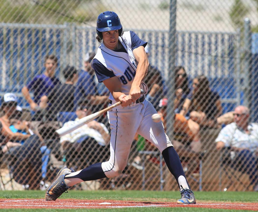 Centennial batter Brett Berger (20) takes a swing during the Sunset Region baseball championship game between Centennial High School and Bishop Gorman High School at Centennial High School on Satu ...