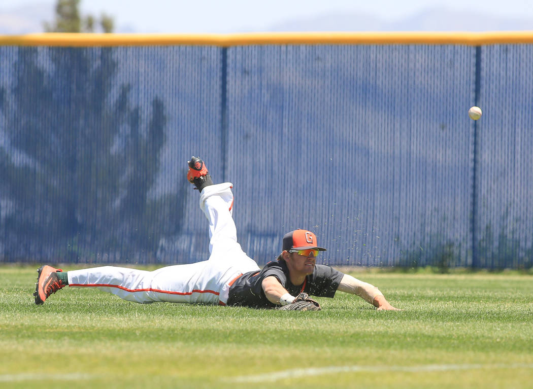 Bishop Gorman right fielder Braxton Wehrle (22) dives for, and misses, a line drive during the Sunset Region baseball championship game between Centennial High School and Bishop Gorman High School ...