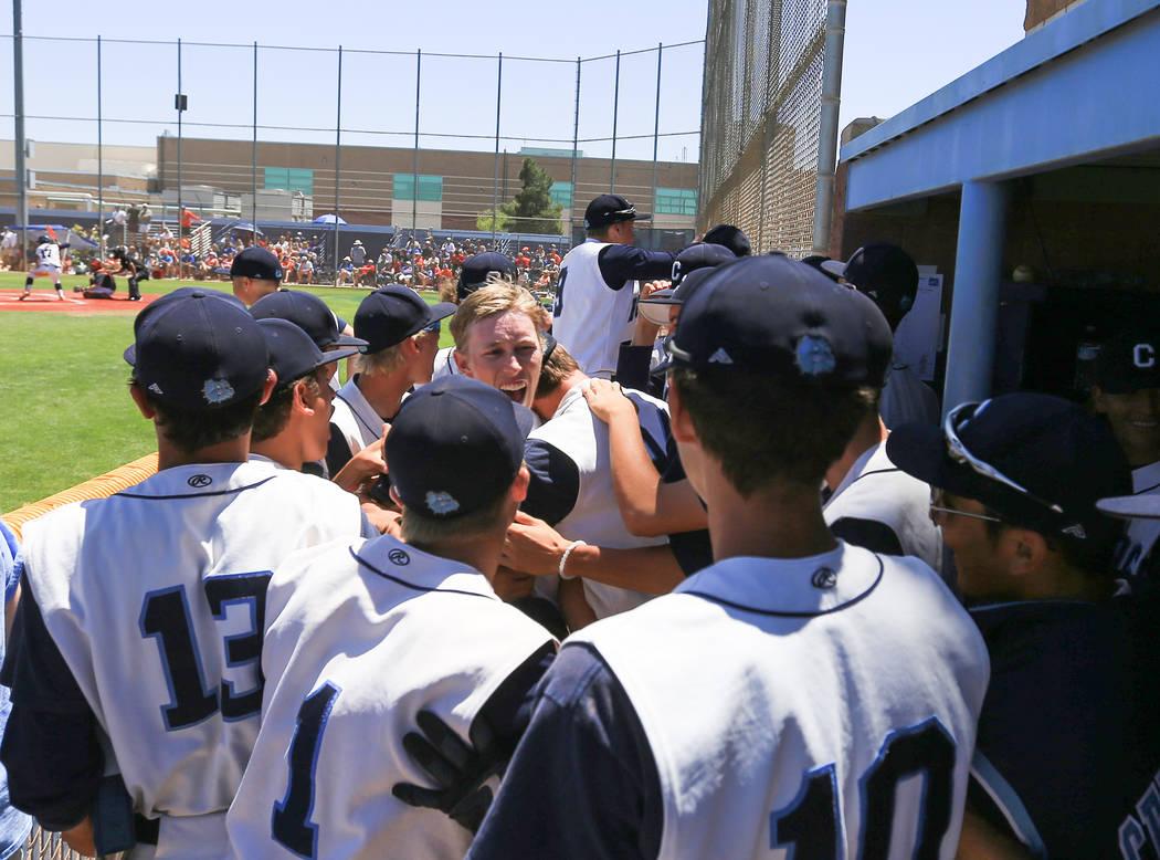Centennial short stop Jake Rogers (42), center, is congratulated after hitting a home run during the Sunset Region baseball championship game between Centennial High School and Bishop Gorman High  ...
