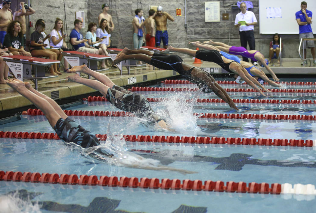 Palo Verde's Emelia Piccininni, left, and Allie Emery, second from left, compete in the 50 yard freestyle during the Sunset Region swim tournament at Buchanan Natatorium at UNLV in Las Vegas on Sa ...