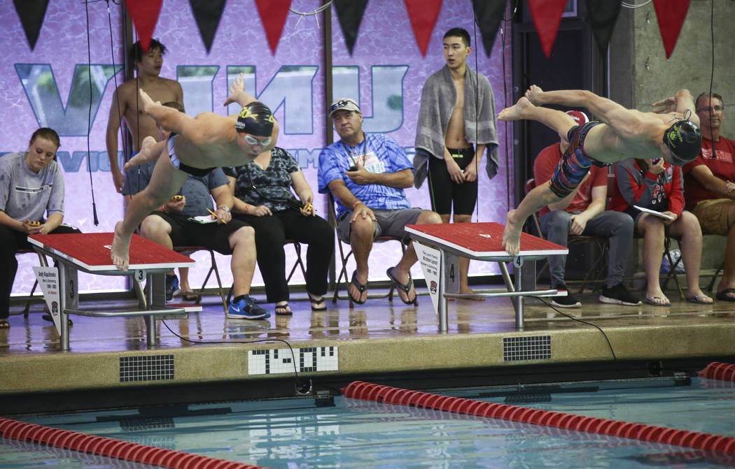 Faith Lutheran's Brayden Guedry, left, and Palo Verde's Dylan Sweikert at the start of the 50 yard freestyle during the Sunset Region swim tournament at Buchanan Natatorium at UNLV in Las Vegas on ...