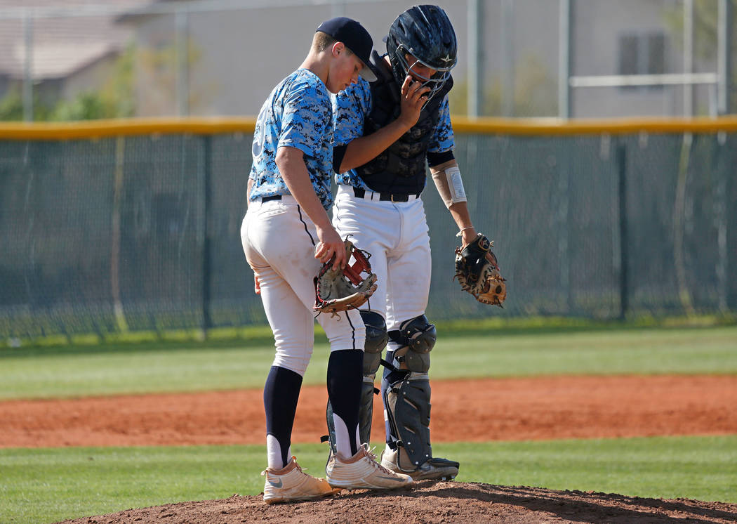 Centennial pitcher Zack Simon, left, talks with catcher Michael Jones during the second inning of a state play-in baseball game against Rancho at Las Vegas High School in Las Vegas, Monday, May 15 ...