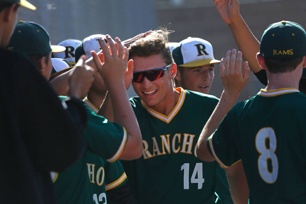 Rancho's Joseph Walls (14) celebrates with his teammates after scoring in the second inning of a state play-in baseball game against Centennial at Las Vegas High School in Las Vegas, Monday, May 1 ...