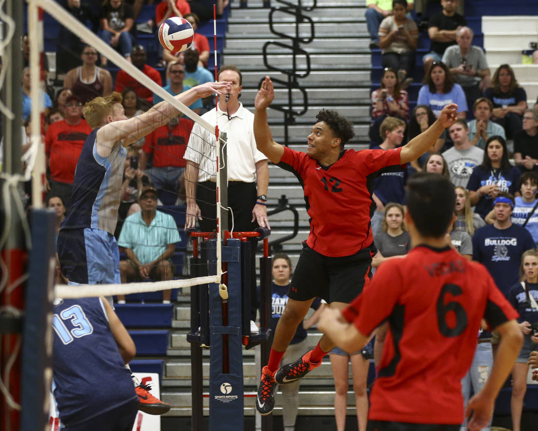Las Vegas' Romeo Gray (12) sends the ball to Centennial during the Class 4A boys state semifinal volleyball game at Coronado High School in Henderson on Tuesday, May 16, 2017. Chase Stevens Las Ve ...