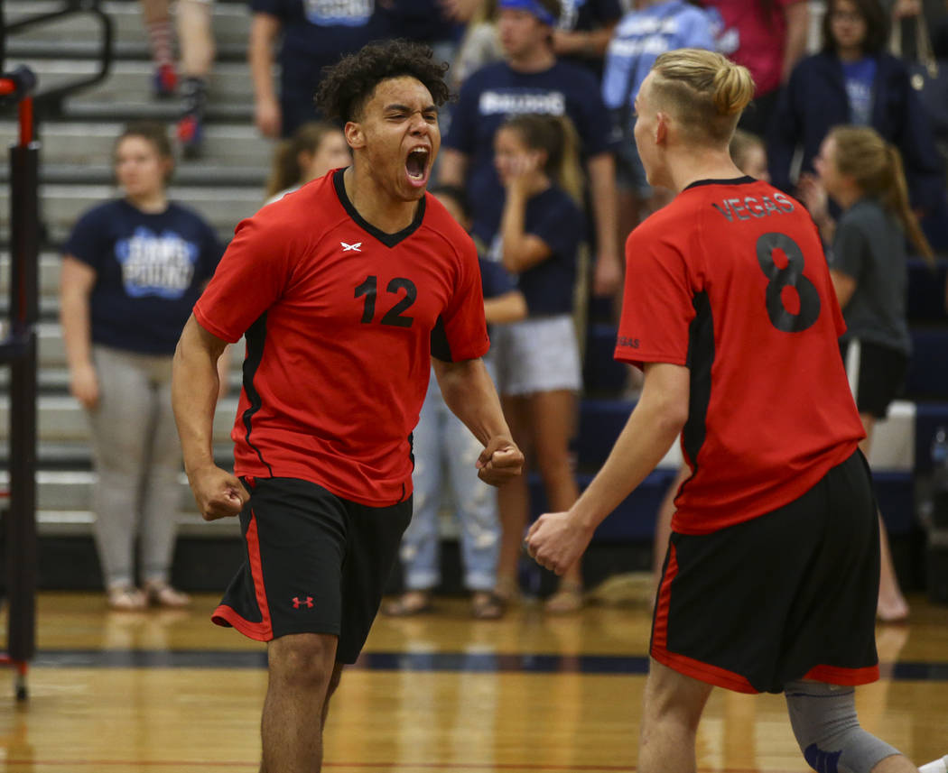Las Vegas' Romeo Gray (12) and Shaun Kampshoff (8) react while playing Centennial during the Class 4A boys state semifinal volleyball game at Coronado High School in Henderson on Tuesday, May 16,  ...