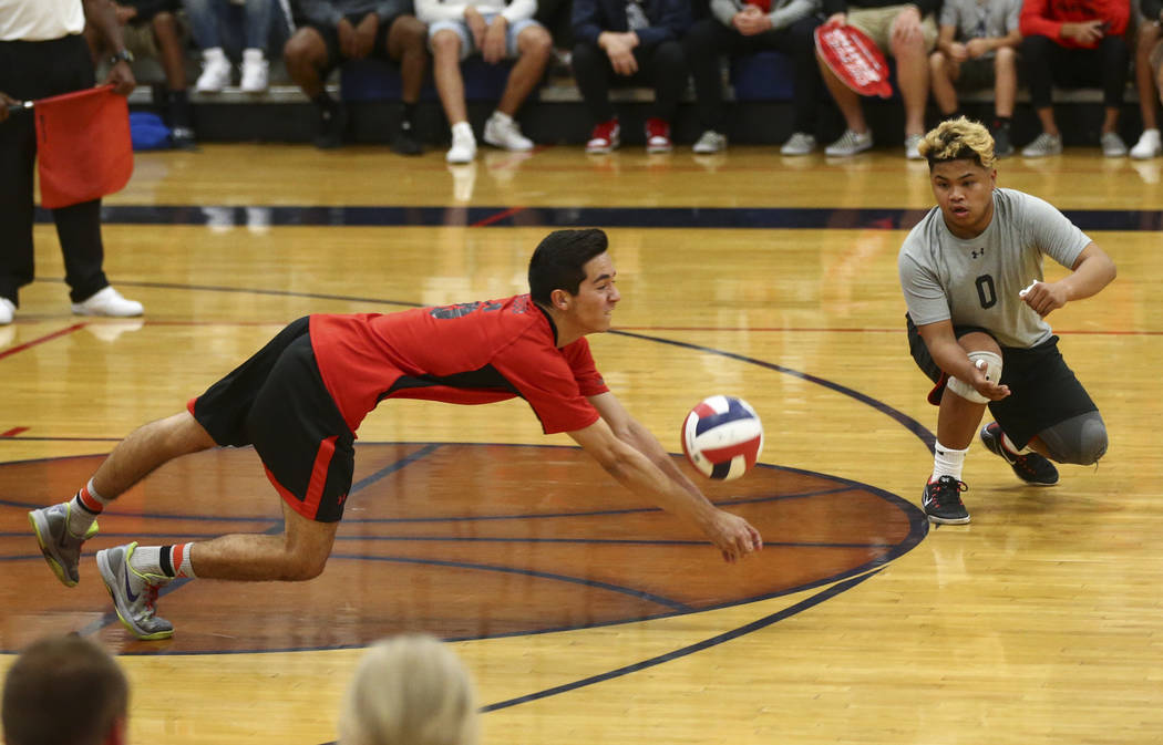 Las Vegas' Jon Sosa dives to save the ball during the Class 4A boys state semifinal volleyball game against Centennial at Coronado High School in Henderson on Tuesday, May 16, 2017. Chase Stevens  ...