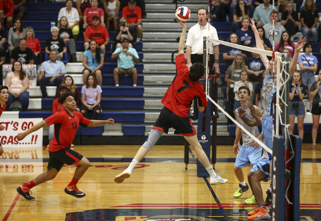 Las Vegas' Elliott Silveira (7) sends the ball over the net to Centennial during the Class 4A boys state semifinal volleyball game at Coronado High School in Henderson on Tuesday, May 16, 2017. Ch ...