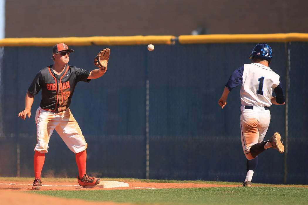 Bishop Gorman first baseman Nick Israel (13) catches a ball to put out Centennial runner Cole Sliwoski (1) during the Sunset Region baseball championship game between Centennial High School and Bi ...