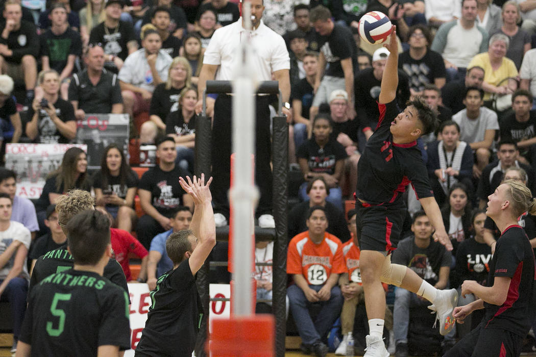 Las Vegas senior Foster Palo (11) hits the ball over the net as Palo Verde attempts to block during the Class 4A state volleyball final at Chaparral High School on Wednesday, May 17, 2017, in Las  ...