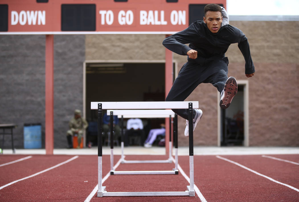 Legacy's Jamaal Britt practices on hurdles at his school in Las Vegas on Wednesday, May 17, 2017. Chase Stevens Las Vegas Review-Journal @csstevensphoto