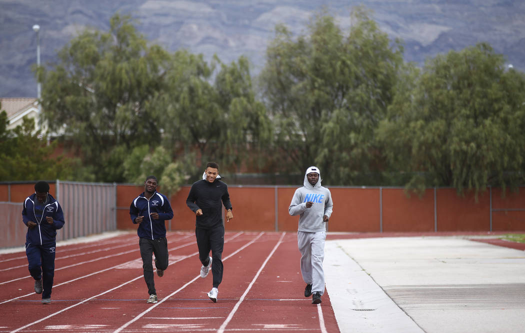 Legacy's Jamaal Britt, third from left, warms up during practice at his school in Las Vegas on Wednesday, May 17, 2017. Chase Stevens Las Vegas Review-Journal @csstevensphoto