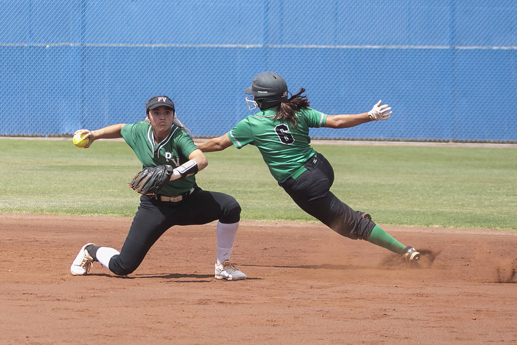Rancho sophomore Lili Gutierrez (6) runs around Palo Verde senior Cara Beatty (5) during a game in the Class 4A state softball tournament at Bishop Gorman High School on Thursday, May 18, 2017, in ...