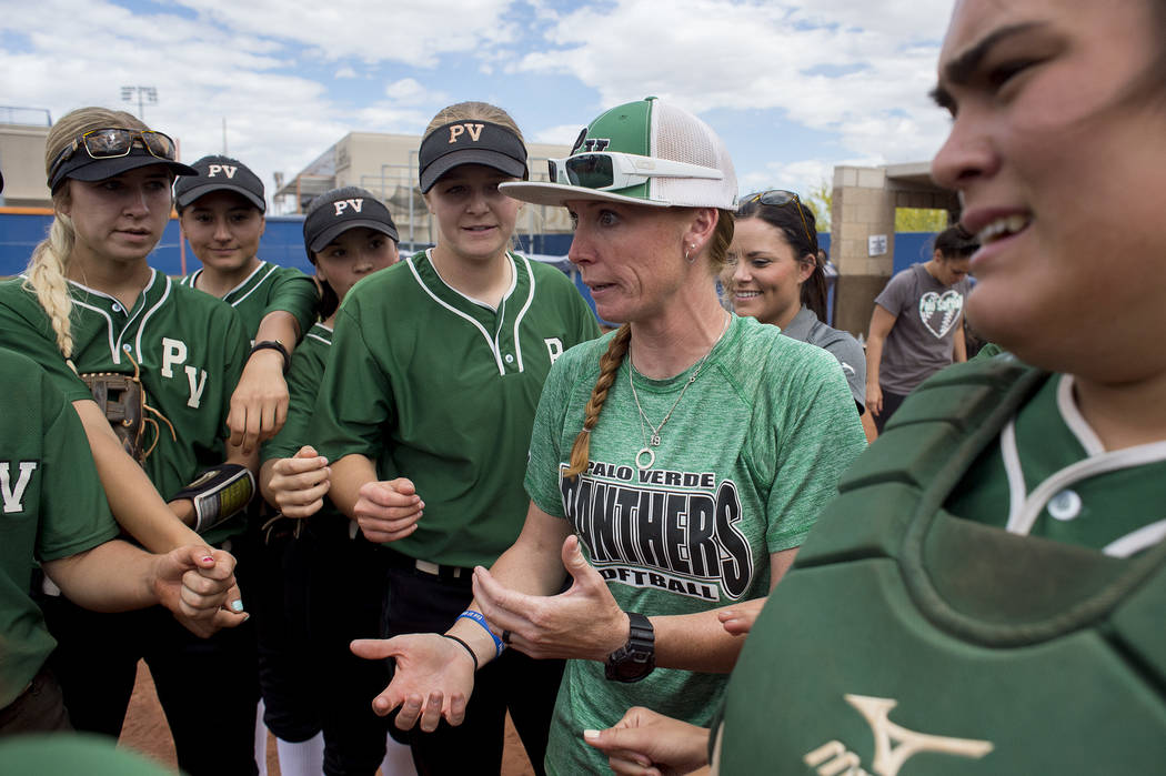 Palo Verde head coach Kelly Glass speaks with the team between innings during their game against Rancho at Bishop Gorman High School in part of the Class 4A state softball tournament on Thursday,  ...