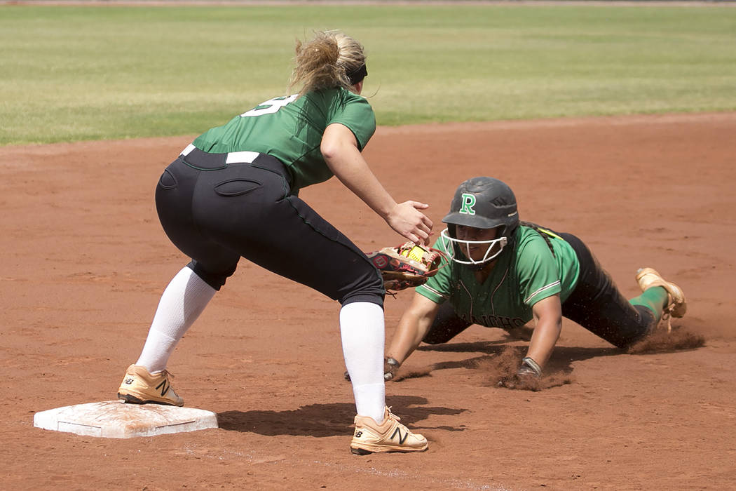 Palo Verde junior Lauryn Barker (9) tags Rancho junior Yvette Sanchez (15) as she slides into third during a game in the Class 4A state softball tournament at Bishop Gorman High School on Thursday ...