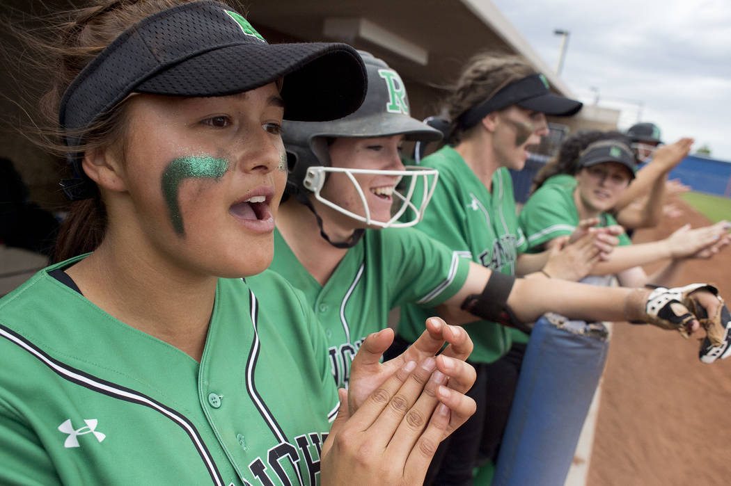 Rancho sophomore Lili Gutierrez (6), left, cheers on her teammates during a game against Palo Verde at Bishop Gorman High School in part of the Class 4A state softball tournament on Thursday, May  ...
