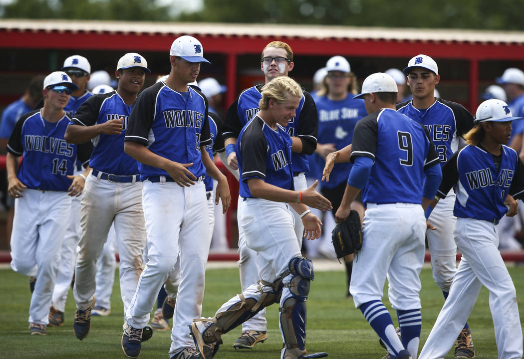 Basic players congratulate pitcher C.J. Dornak (9) after the team defeated Galena 12-0 in 5 innings in a Class 4A state baseball tournament game at Las Vegas High School in Las Vegas on Thursday,  ...