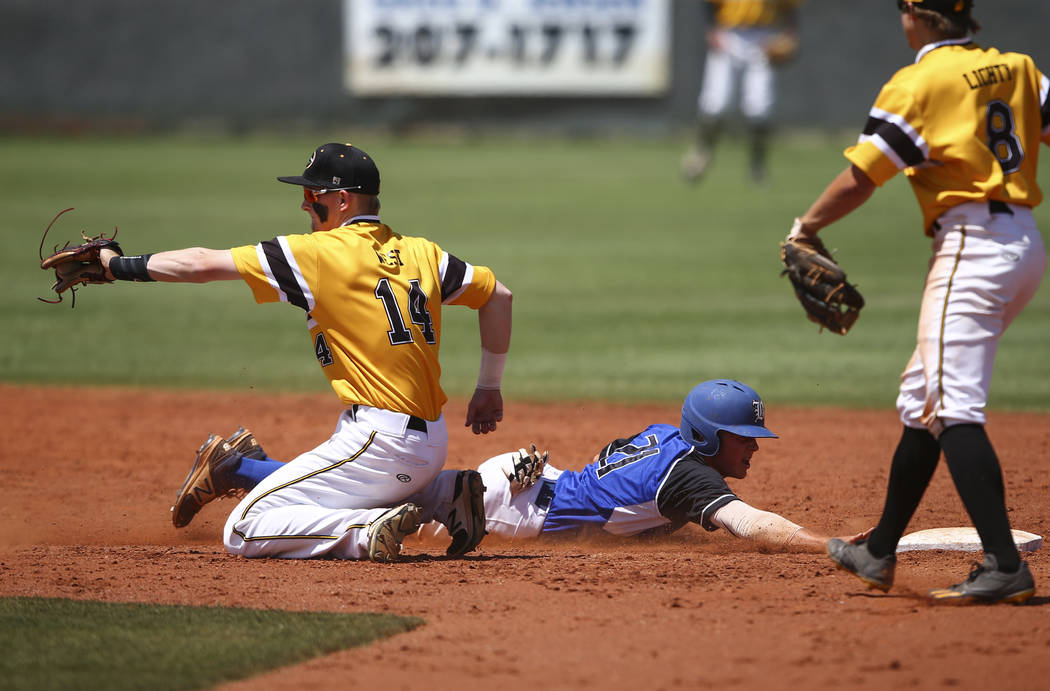 Basic's Paul Myro (21) makes it safely back to second base against Galena's Andrew West (14) during a Class 4A state baseball tournament game at Las Vegas High School in Las Vegas on Thursday, May ...