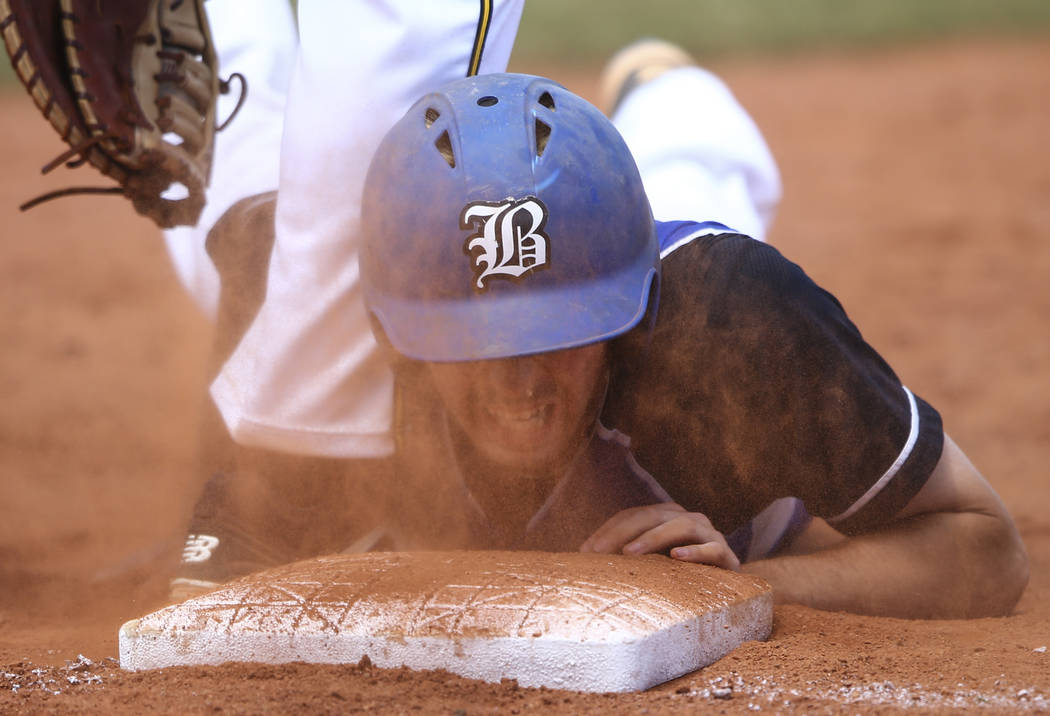 Basic's Roger Riley avoids getting tagged out by Galena's Austin Wickham, not pictured, during a Class 4A state baseball tournament game at Las Vegas High School in Las Vegas on Thursday, May 18,  ...