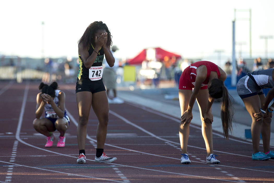 Rancho junior Gizelle Reid reacts after placing first in the girls 4A 400-meter dash at the NIAA State Track & Field Championships at Foothill High School on Friday, May 19, 2017 in Henderson. ...