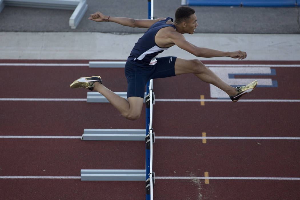 Legacy senior Jamaal Britt takes the lead during the boys 300-meter hurdles at the NIAA State Track & Field Championships at Foothill High School on Friday, May 19, 2017 in Henderson. Britt pl ...