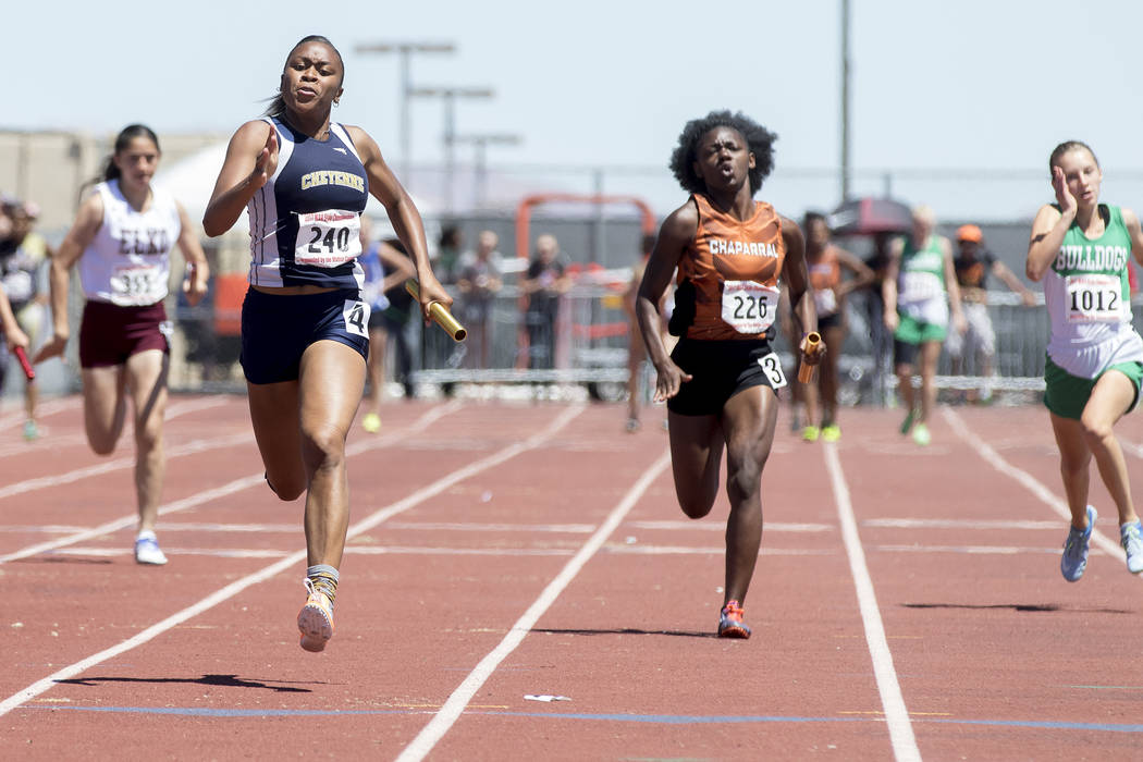 Cheyenne senior Angela Hammond finishes the last leg of the girls 400-meter relay during the NIAA 3A State Track & Field Championships at Foothill High School on Saturday, May 20, 2017 in Hend ...