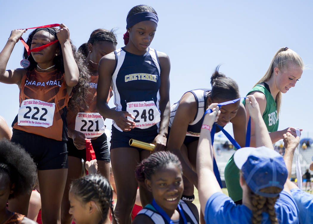 Cheyenne runners receive their medals in the girls 400-meter relay during the NIAA 3A State Track & Field Championships at Foothill High School on Saturday, May 20, 2017 in Henderson. Cheyenne ...
