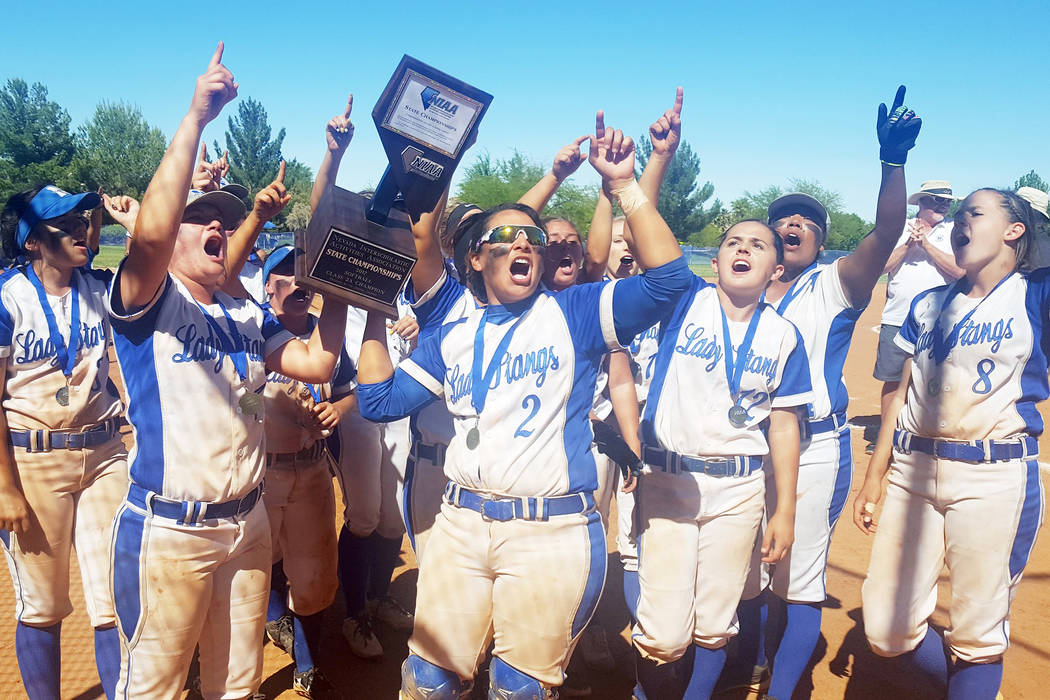 The Needles softball team holds its Class 2A State Championship trophy high, while singing the school fight song on Saturday, after defeating Lincoln County in the title game. (W.G. Ramirez/Las Ve ...