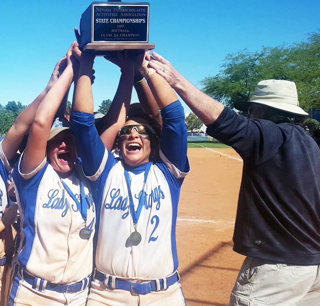 Jaycee Fragoso and Brenna Chavez hoist the Class 2A State Championship trophy after Needles knocked off Lincoln County on Saturday in the title game. (W.G. Ramirez/Las Vegas Review-Journal)