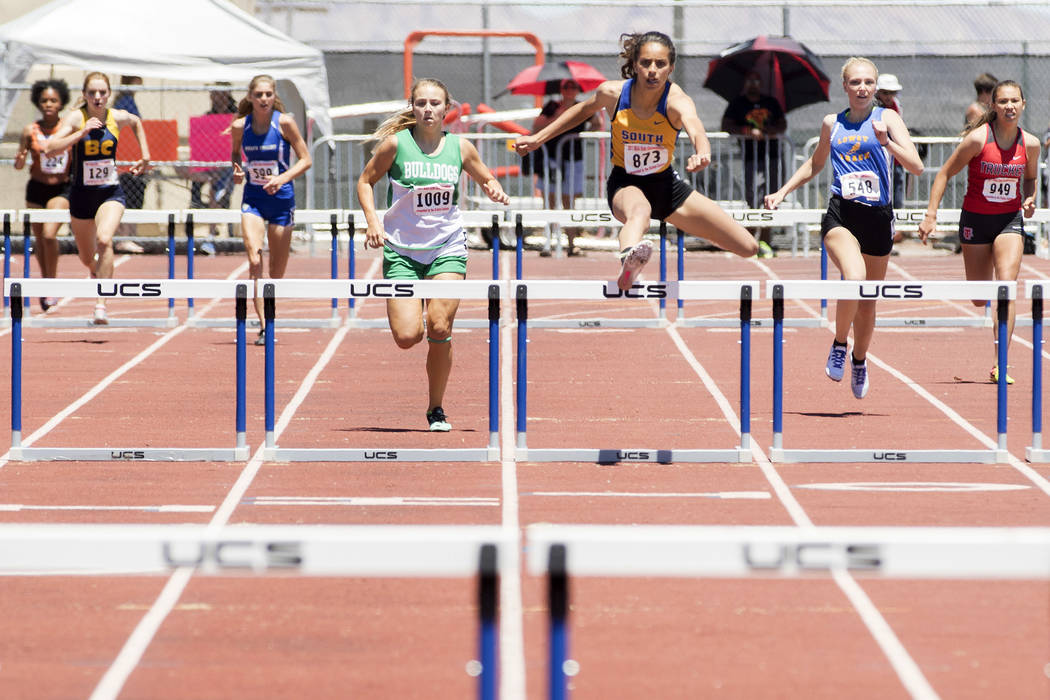 South Tahoe senior Maya Brosch clears a hurdle during the girls 300-meter hurdles during the NIAA 3A State Track & Field Championships at Foothill High School on Saturday, May 20, 2017 in Hend ...