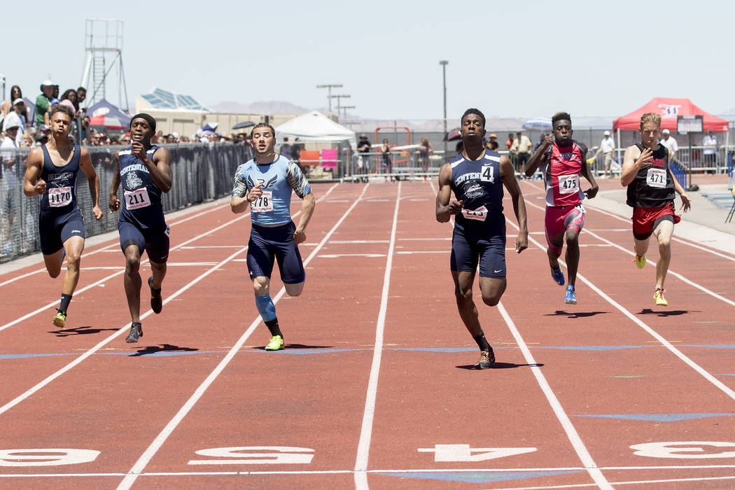 Centennial senior Savon Scarver takes the lead in the boys 200-meter dash during the NIAA State Track & Field Championships at Foothill High School on Saturday, May 20, 2017 in Henderson. Scar ...