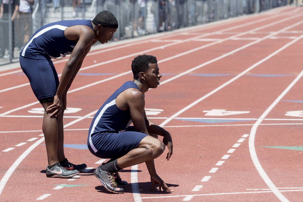 Centennial senior Savon Scarver, right, and Centennial junior Randall Jubilee, left, wait to see their times after their finish in the boys 200-meter dash during the NIAA State Track & Field C ...