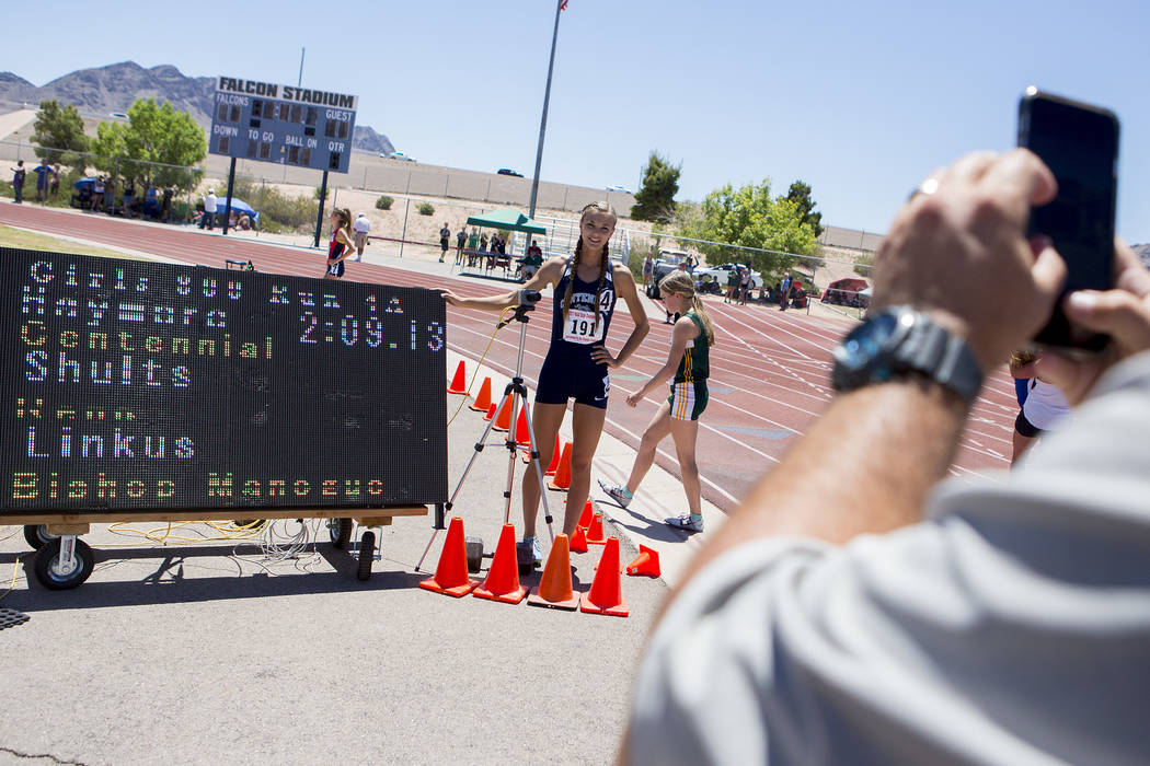 Centennial senior Karina Haymore takes a picture with her time after the girls 800-meeter run during the NIAA State Track & Field Championships at Foothill High School on Saturday, May 20, 201 ...