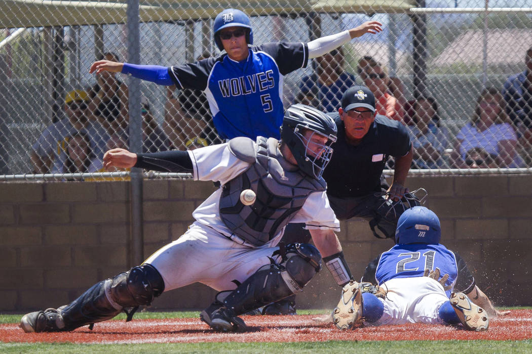 Basic's Paul Myro, right, slides safely into home plate with the final run of a 16-6 win over Galena in the NIAA Class 4A State Championship baseball game at Las Vegas High School in Las Vegas on  ...