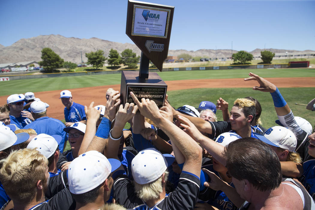 Basic players celebrate with their trophy after defeating Galena in the NIAA Class 4A State Championship baseball game at Las Vegas High School in Las Vegas on Saturday, May 20, 2017. Richard Bria ...
