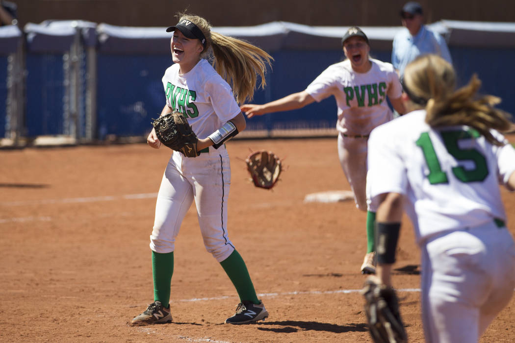 Palo Verde's Kendall Hopkins (8), left, reacts after a strikeout to win against Reed in the Nevada Class 4A state softball final on Saturday, May 20, 2017 in Las Vegas. Palo Verde won 9-3. Erik Ve ...
