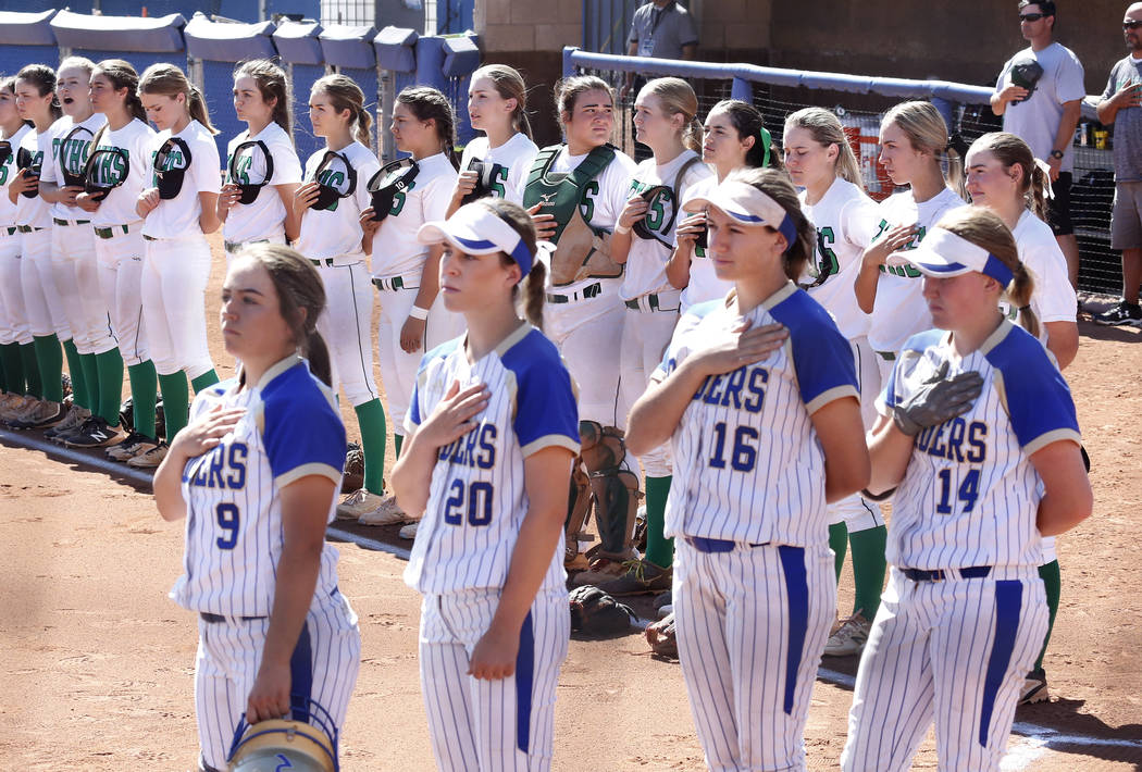Reed High School, forergound, and Palo Verde High School softball teams during the national anthem before their Class 4A State Championship game in Las Vegas on Saturday, May 20, 2017. Bizuayehu T ...