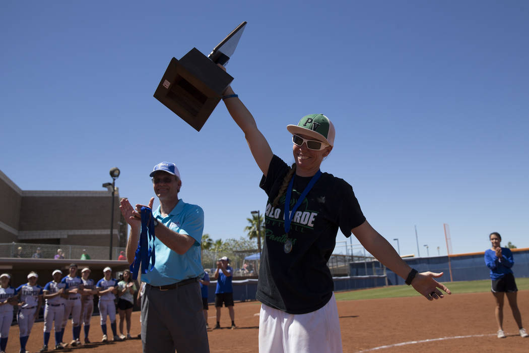 Palo Verde head coach Kelly Glass raises the championship trophy after her team's 9-3 win against Reed in the Nevada Class 4A state softball final on Saturday, May 20, 2017 in Las Vegas. Erik Verd ...