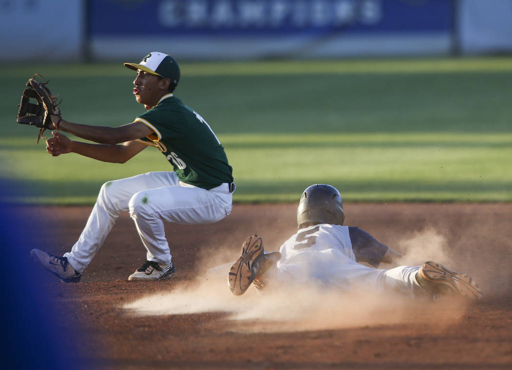Spring Valley's Otis Jaxson (5) makes it to second base against Rancho's David Arambula (16) during the Class 4A All-Star baseball game at the College of Southern Nevada's Morse Stadium in Henders ...