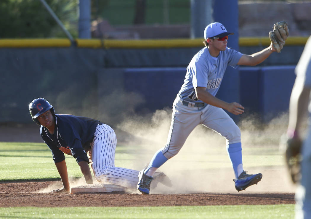 Centennial's Tanner Wright tags out Coronado's Noah Hemphill at third base during the Class 4A All-Star baseball game at the College of Southern Nevada's Morse Stadium in Henderson on Thursday, Ma ...