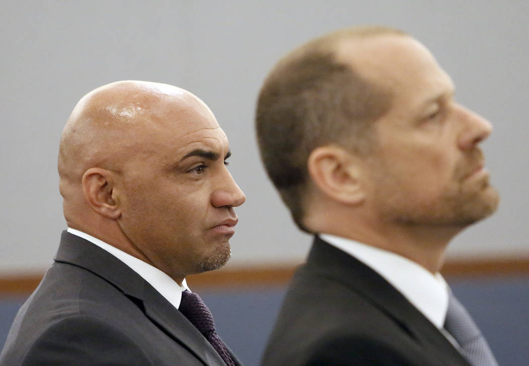 Kenny Sanchez, left, Bishop Gorman's head football coach charged with domestic violence against his ex-girlfriend, and his attorney Ross Goodman listen as the judge announces the not guilty verdic ...