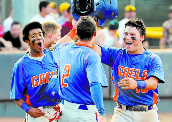Bishop Gorman catcher Michael Blasko, right, shown May 16 with teammates Cadyn Grenier (2) and Willie Jumper after homering against Coronado in the Division I state tournament, is the lone catcher ...