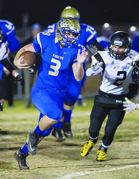 Reed quarterback Chris Denn has rushed for 1,262 yards and passed for 2,619 yards this season. He leads the Railroaders into Saturday's Division I state championship game against Bishop Gorman.